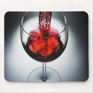 Wine poured in glass mouse pad