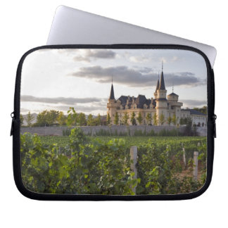Winery building seen from the vineyard at laptop computer sleeve