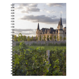 Winery building seen from the vineyard at spiral notebook