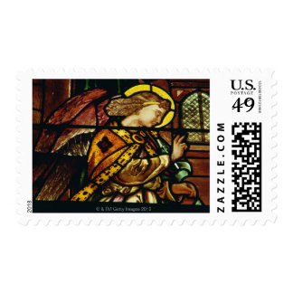 Winged angel in stained glass window stamp