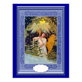 Winged angel under a star postcard