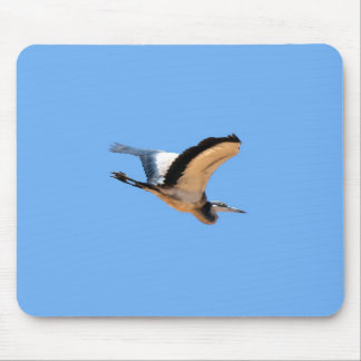 Winged great blue heron bird in flight mouse pad