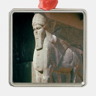 Winged human-headed bull, Neo-Assyrian Period Metal Ornament