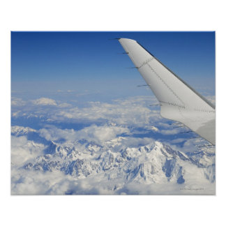 Wings of flying airplane over French Alps, Poster