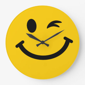 Winking smiley face wall clocks