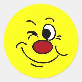 Winking Smiley Face Grumpey Classic Round Sticker