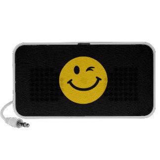 Winking smiley face laptop speaker