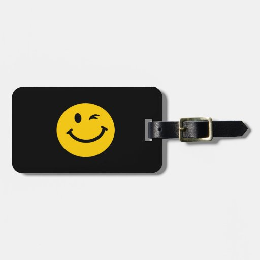 Winking smiley face bag tag