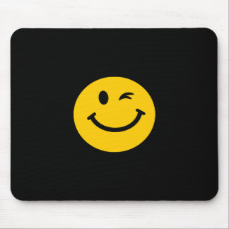 Winking smiley face mouse pad