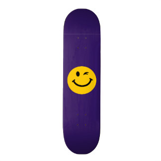 Winking smiley face skateboard deck