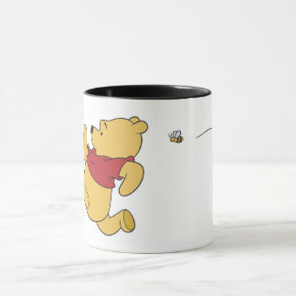 Winnie The Pooh chased by bee Mug