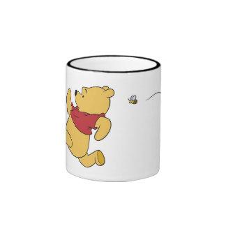 Winnie The Pooh chased by bee Ringer Coffee Mug