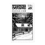 winter cabin postage stamp