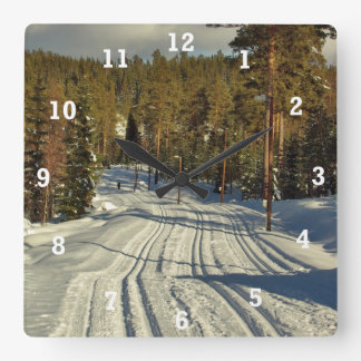 Winter day in Sweden Square Wall Clock