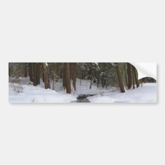 Winter forest and a river with snow and ice bumper stickers