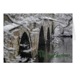 Winter scene Christmas card with a snowy bridge