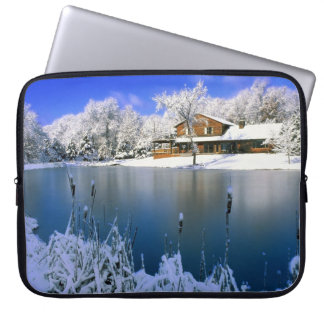 Winter scene, house by the lake computer sleeves