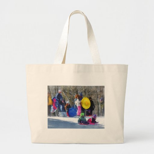 Winter - Sledding in the Park Canvas Bags