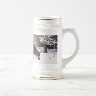 Winter snow scene with cute black and tan dog beer stein