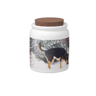 Winter snow scene with cute black and tan dog candy jar