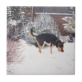 Winter snow scene with cute black and tan dog ceramic tile