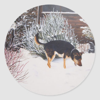 Winter snow scene with cute black and tan dog classic round sticker