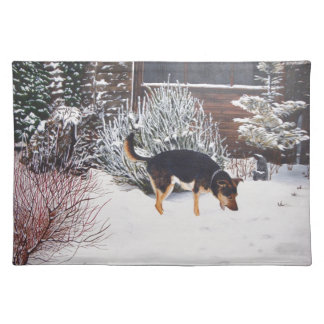 Winter snow scene with cute black and tan dog cloth placemat