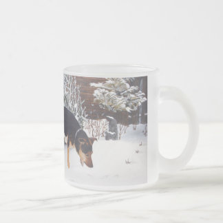 Winter snow scene with cute black and tan dog frosted glass coffee mug