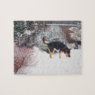 Winter snow scene with cute black and tan dog jigsaw puzzle