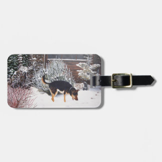 Winter snow scene with cute black and tan dog luggage tag