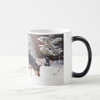 Winter snow scene with cute black and tan dog magic mug