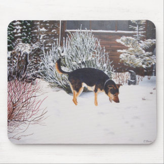 Winter snow scene with cute black and tan dog mousepad
