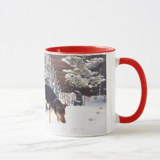 Winter snow scene with cute black and tan dog mug