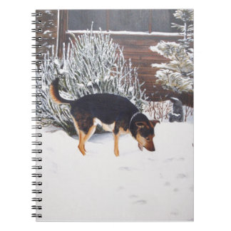 Winter snow scene with cute black and tan dog spiral note books