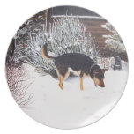 Winter snow scene with cute black and tan dog plate