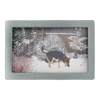 Winter snow scene with cute black and tan dog rectangular belt buckle