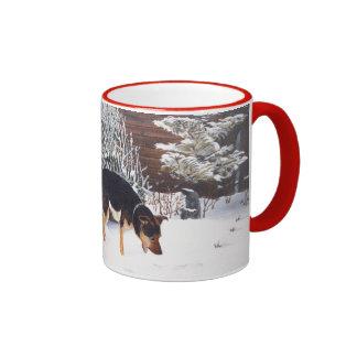 Winter snow scene with cute black and tan dog ringer mug