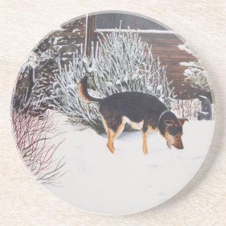 Winter snow scene with cute black and tan dog sandstone coaster