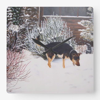 Winter snow scene with cute black and tan dog square wall clock