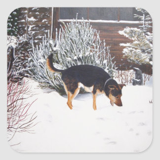 Winter snow scene with cute black and tan dog square sticker