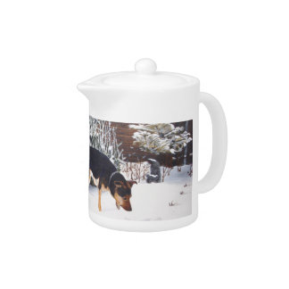 Winter snow scene with cute black and tan dog teapot