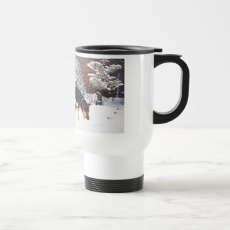 Winter snow scene with cute black and tan dog travel mug