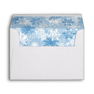 Winter snowflakes pattern on blue envelope