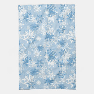 Winter snowflakes pattern on blue hand towel
