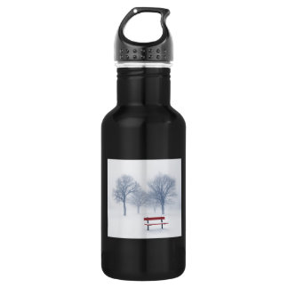Winter trees and bench in fog 18oz water bottle