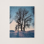Winter trees on twilight blue sky jigsaw puzzles