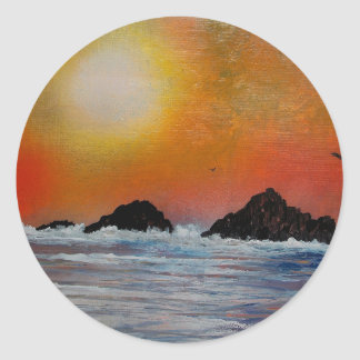 Wintry sunset at sea classic round sticker