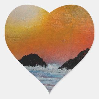 Wintry sunset at sea heart sticker
