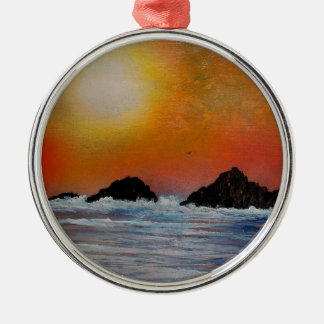 Wintry sunset at sea metal ornament