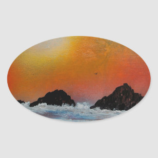 Wintry sunset at sea oval sticker